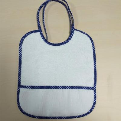 Bavoir Bébé Blanc avec liseret bleu à Pois et poche Aida 5 pts