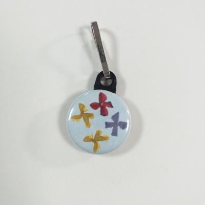 Tirette zip  badge fermeture éclair 4  Noeuds sur fond gris