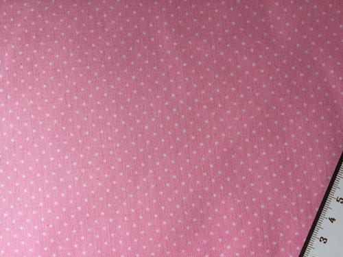 Tissu a pois sur fond rose