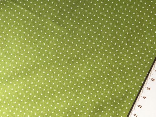Tissu a pois sur fond vert