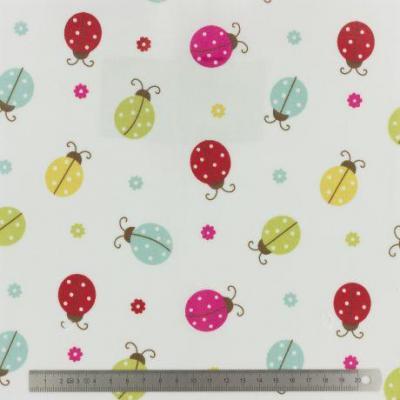 Tissu Fryett's enduit ladybird multi